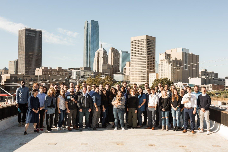 Full team photo in OKC office